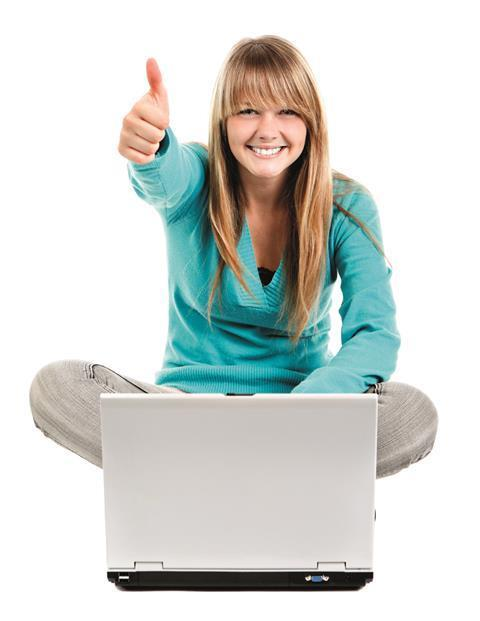 A student on her laptop giving a thumbs up