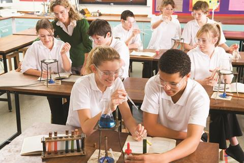 Secondary school students doing practical science