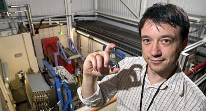Figure 5 - Michael Preuss holding a test sample at the ENGIN-X instrument