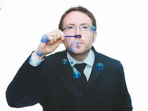 A man blowing coloured bubbles